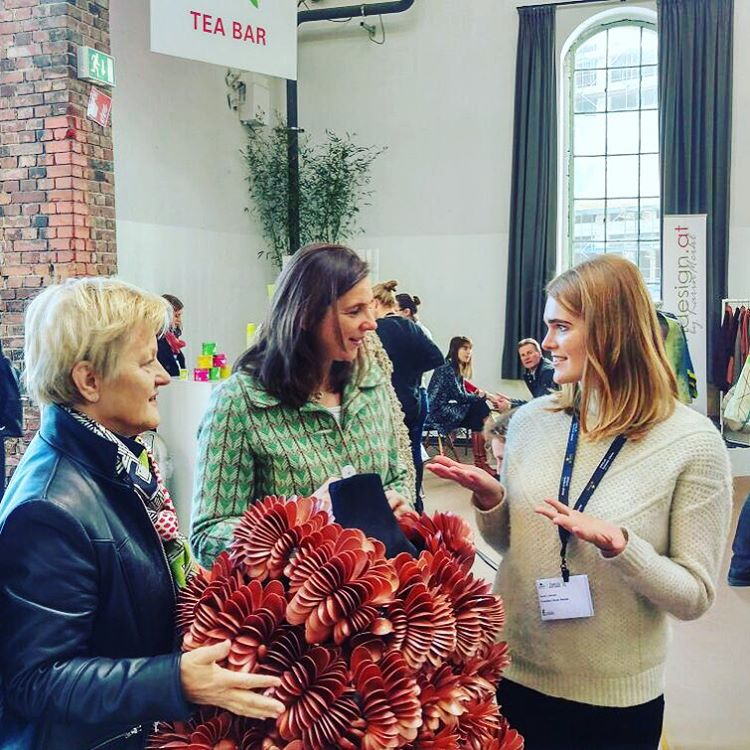 """Our award winner Anne Lonnes met the politicians Renate Künast and Katrin Göring-Eckardt at the @greenshowroom today. She had the chance to show them her design """"Reincarnation"""" made out of over 3.000 plastic spoons! #greenshowroom #mbfwb #ecologicalgreen #fashiondesign #ecoconscious #tradefair"""